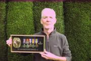Joe Dunn with his grandfather's medals