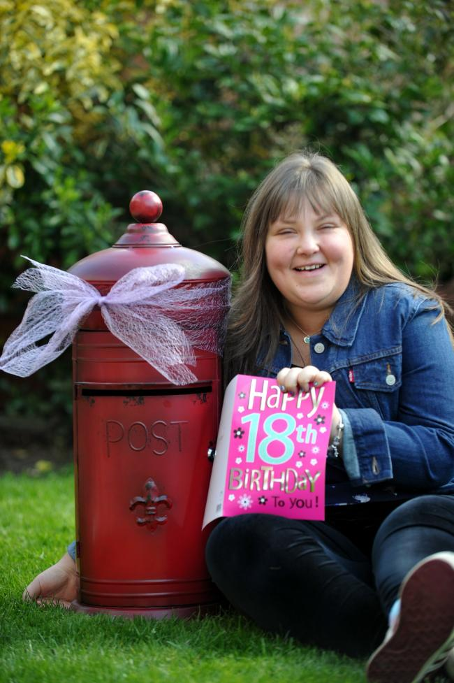 Beth Wilcock who has had 2 open heart surgeries celebrated her 18th birthday and asked for donations to Alder Hey charity instead of receiving presents, pictured at her Astley home with the Post Box she asked for donations to be posted in   (23847544)