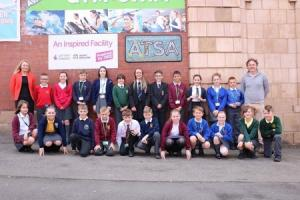 Primary school pupils who designed the new ATSA Sports Council logo stand outside The Pelican Centre in Tyldesley on Monday