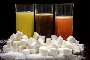 Sugar tax survives but tax avoidance plans delayed as MPs approve slimmed Budget