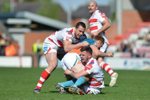 Leigh make a tackle against Hull KR. Picture: Paul McCarthy