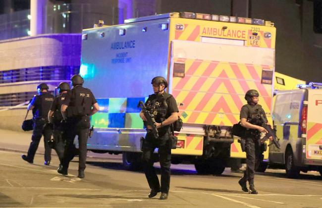 Police at the scene as a suicide bomber killed 22 people and seriously injured dozens more at the Manchester Arena. Picture: PA