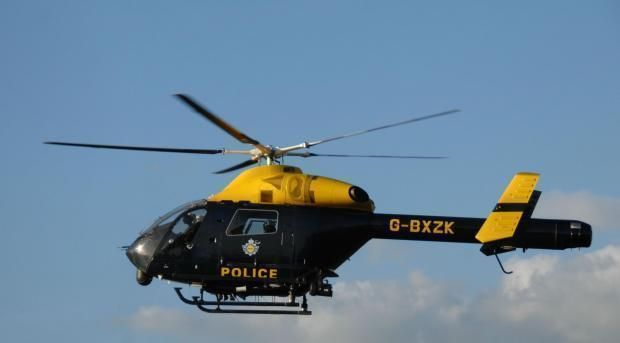 A police helicopter was hovering over Leigh yesterday morning, Wednesday