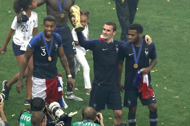 Presnel Kimpembe, Antoine Griezmann and Samuel Umtiti, left to right