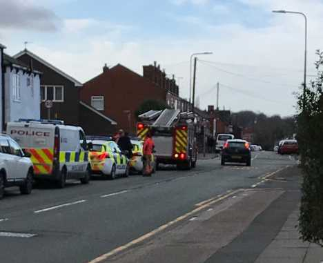 Police at Heath Street in Golborne, near Prescott Street. Picture: Jo Robinson