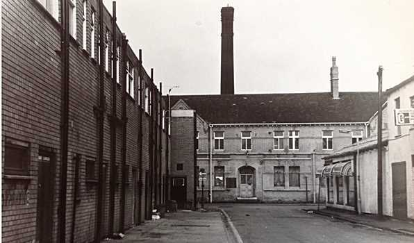 A photograph showing  the old swimming baths building on Silk Street in Leigh, taken in 1982 after it was shut in 1977
