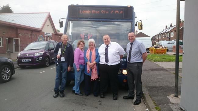 From left; Cllr Stephen Hellier, resident Agnes Raftry, Shakerley Community Centre's Marjorie Marsden, Diamond Bus Operations Manager and Assistant Operations Manager, Mark Butler and Paul Lamb with a 694 bus at Shakerley Community Centre