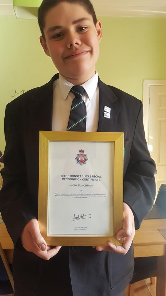 Michael Norman with his Chief Constable's Special Recogntion Certificate, which was presented to him by Greater Manchester Police