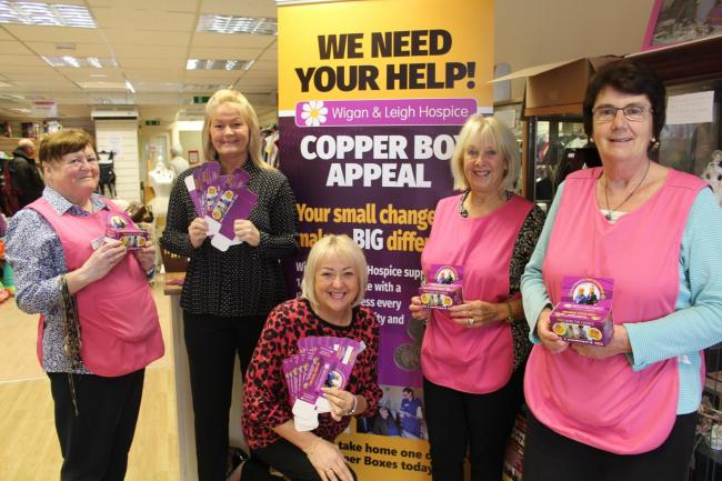 Hospice workers and volunteers in front of the Copper Box Appeal display on Bradshawgate in Leigh. From left; Lynda Riley, Christine Edwardson, Maxine Armstrong, Kath Feely and Carol Collier